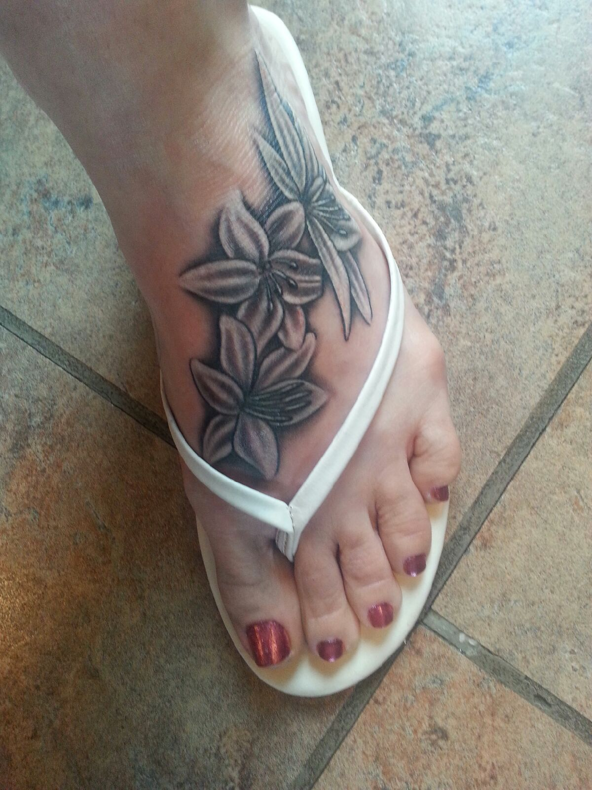 Black And White Beautiful Flower Lily Foot Tattoo Sweet Tattoos