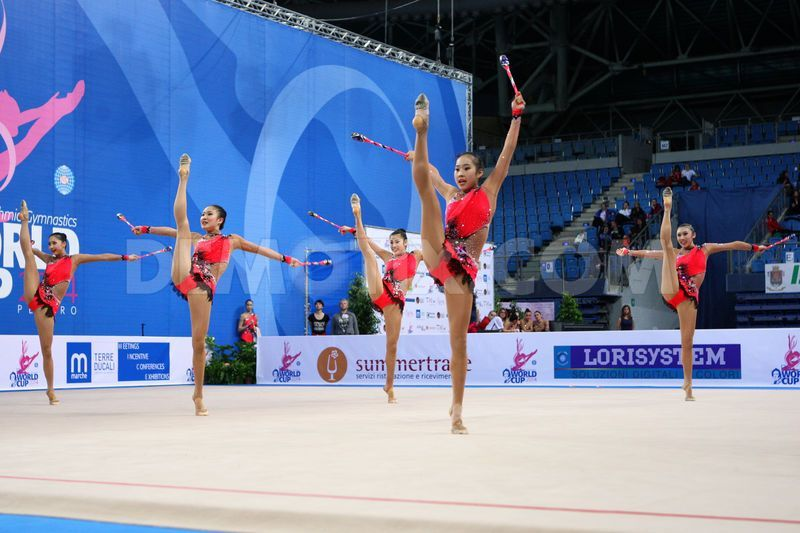 Japan's team performing the clubs routine during the FIG Rhythmic Gymnastic World Cup series Pesaro 2014.