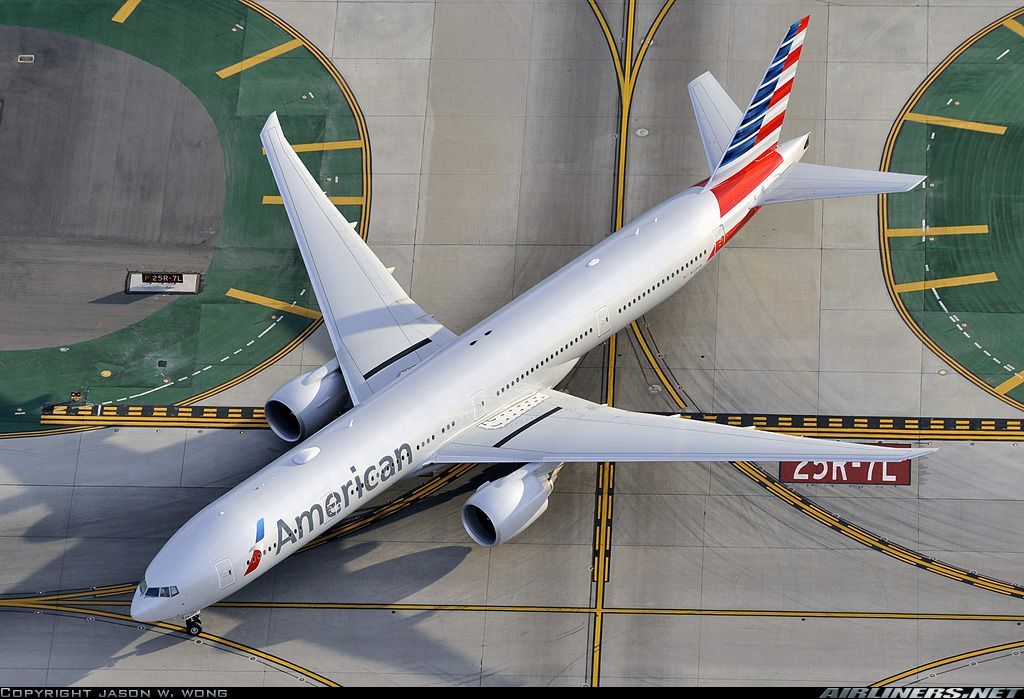 A birds eye view of an American Airlines 773ER taxiing at