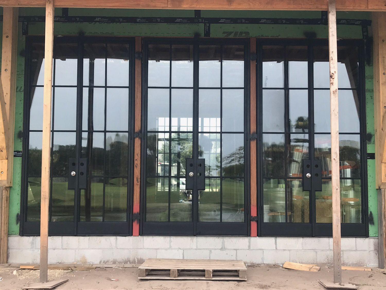 FireRock steel doors being installed for a luxury custom home in Jacksonville FL & FireRock steel doors being installed for a luxury custom home in ...