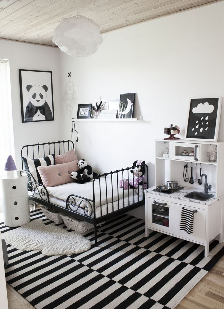 Modern black and white girl\'s room with blush pink pillows ...