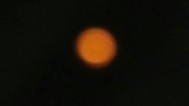The moon looks like mars tonight