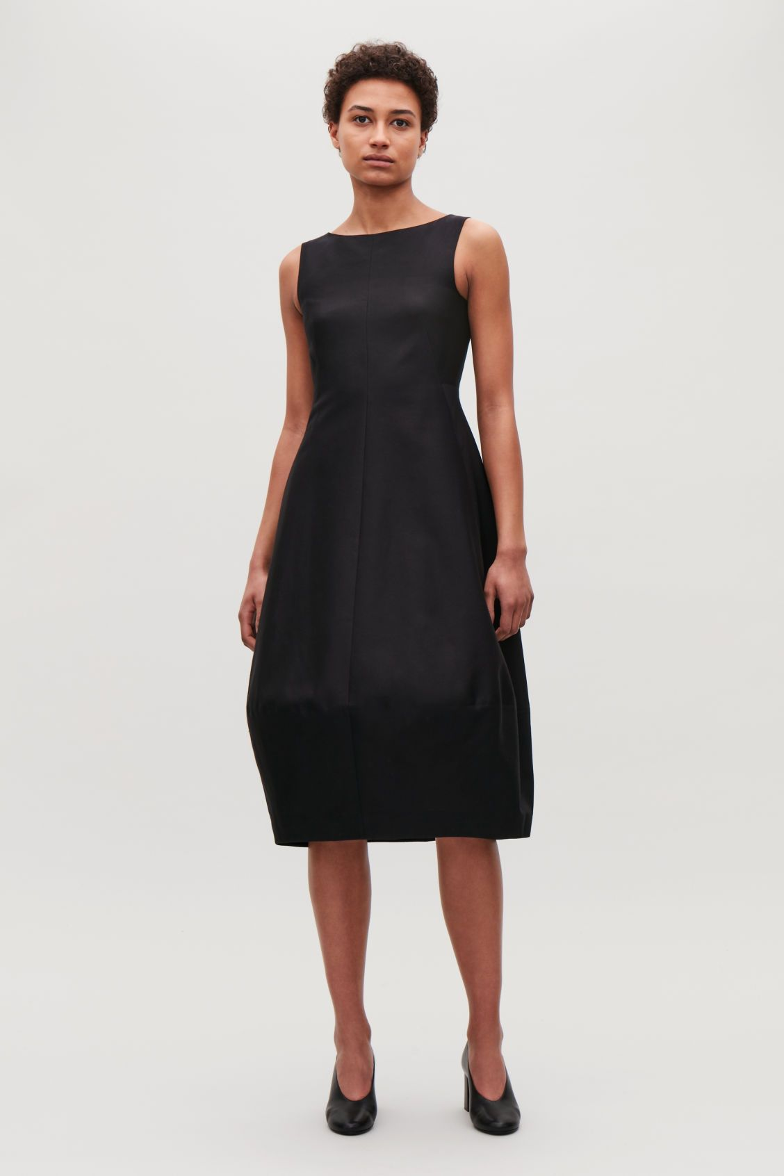 f25813e38839a Model front image of Cos sleeveless cocoon dress in black | Capsule ...