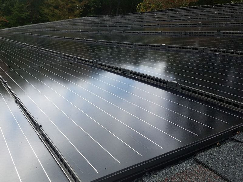 """Solar Shingles that are """"builtin"""" the roof protect the"""