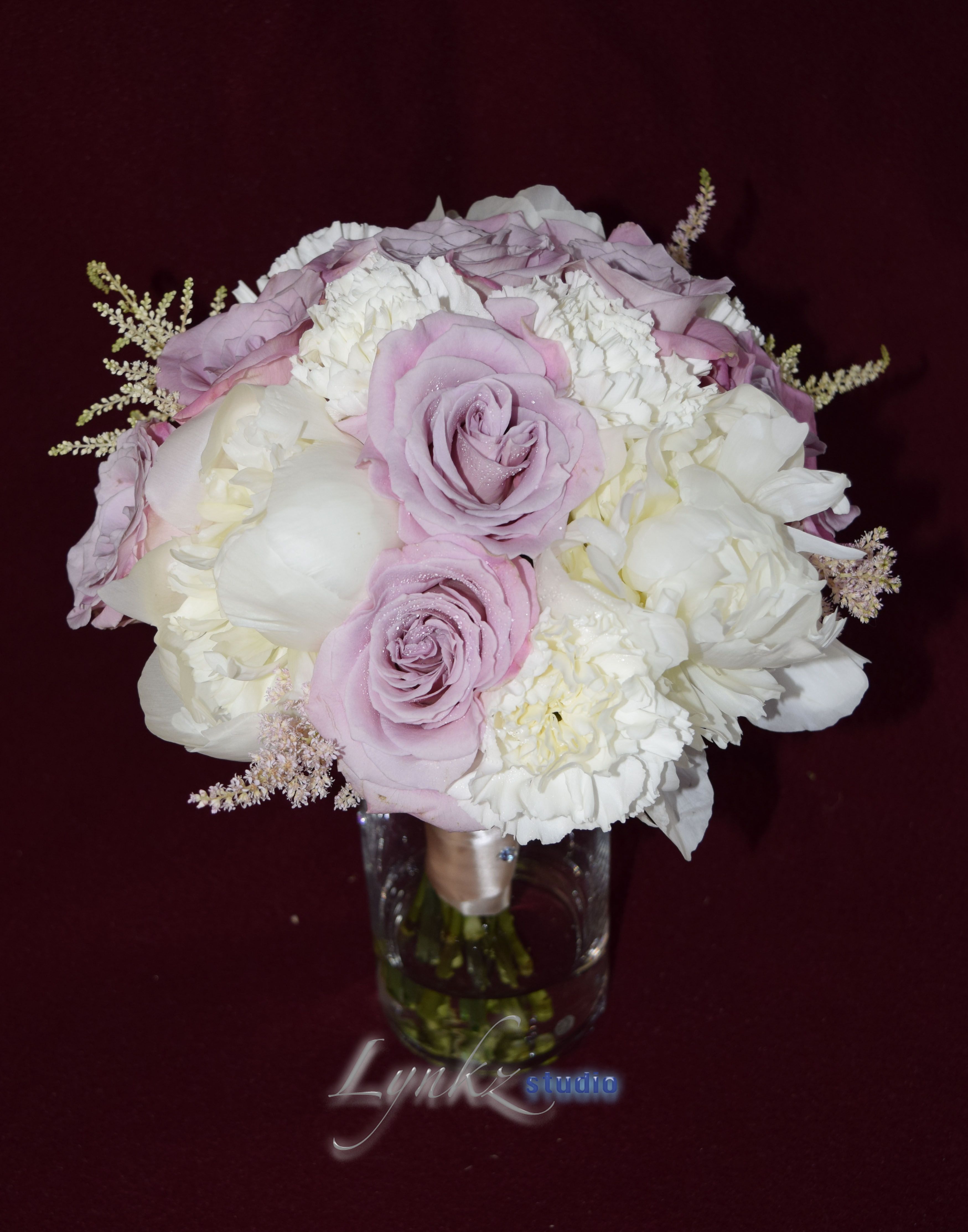 bride'smaids bouquet with white peonies, roses, carnations and