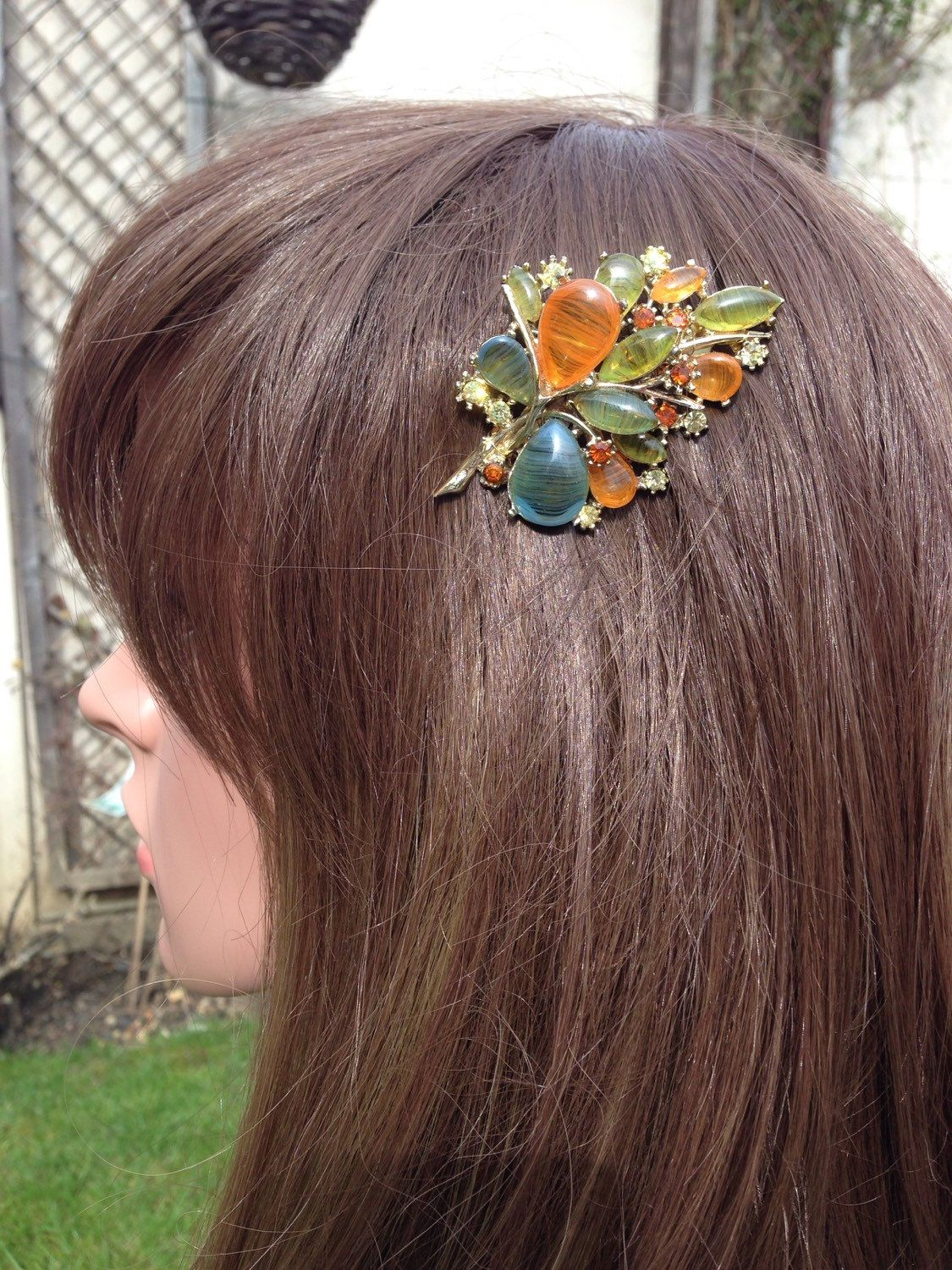 A personal favourite from my Etsy shop https://www.etsy.com/uk/listing/274384706/orange-green-venetian-glass-hair-comb