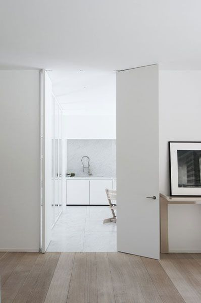 Raise doors to the ceiling height. It helps create the illusion of a  generous space.