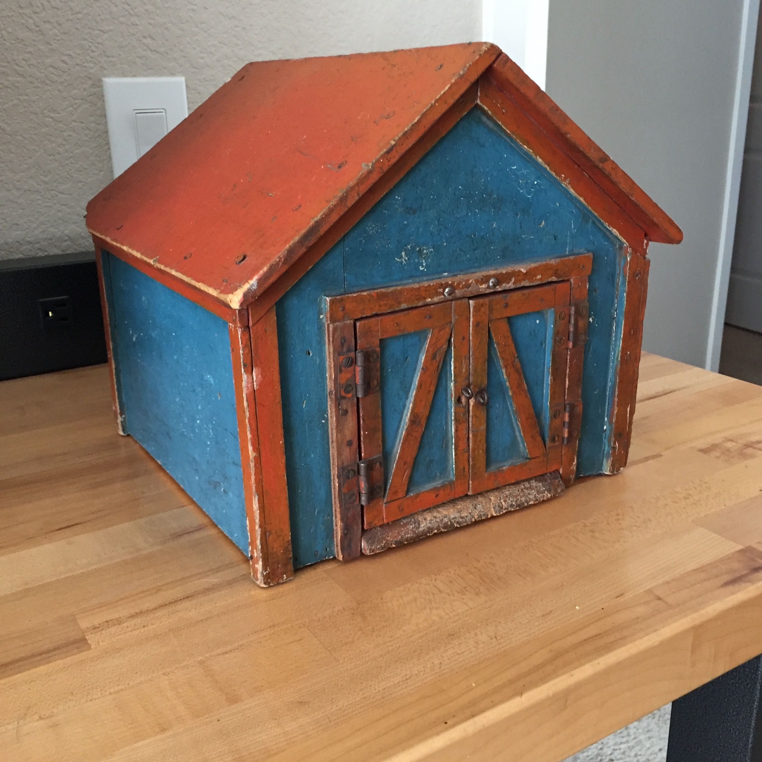 Adorable antique blue painted barn wred roof and trim