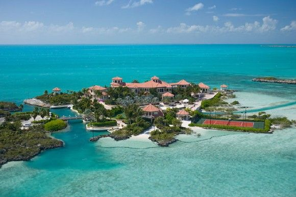 Originally up for sale for $75 million Tim Blixseth's Emerald Cay in Turks 7 Caicos is a 27,000 sq.ft. private island has a guest house, a 'floating' tennis court, swimming pool, a gym, movie theatre, three-story library and a wine cellar that holds 8,000 bottles. The island also has a several docks and a man-made beach. It connects to the mainland via a retractable bridge.