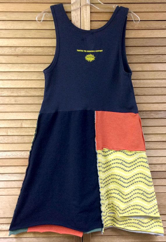 This funky, upcycled tunic/sundress was made from a twisted tea tank, a Beatles Yellow Submarine tshirts and bright colored coordinating shirts. Perfect everyday summer dress or tunic. Layer it up with leggings and you favorite denim jacket on cooler days! The bottom of the dress has exposed seams, to add interest. Seams are sewn with a special stretch stitch, so no seams will not break when you move in this dress! All seams are sewn with black thread for contrast and interest.. Easy to...