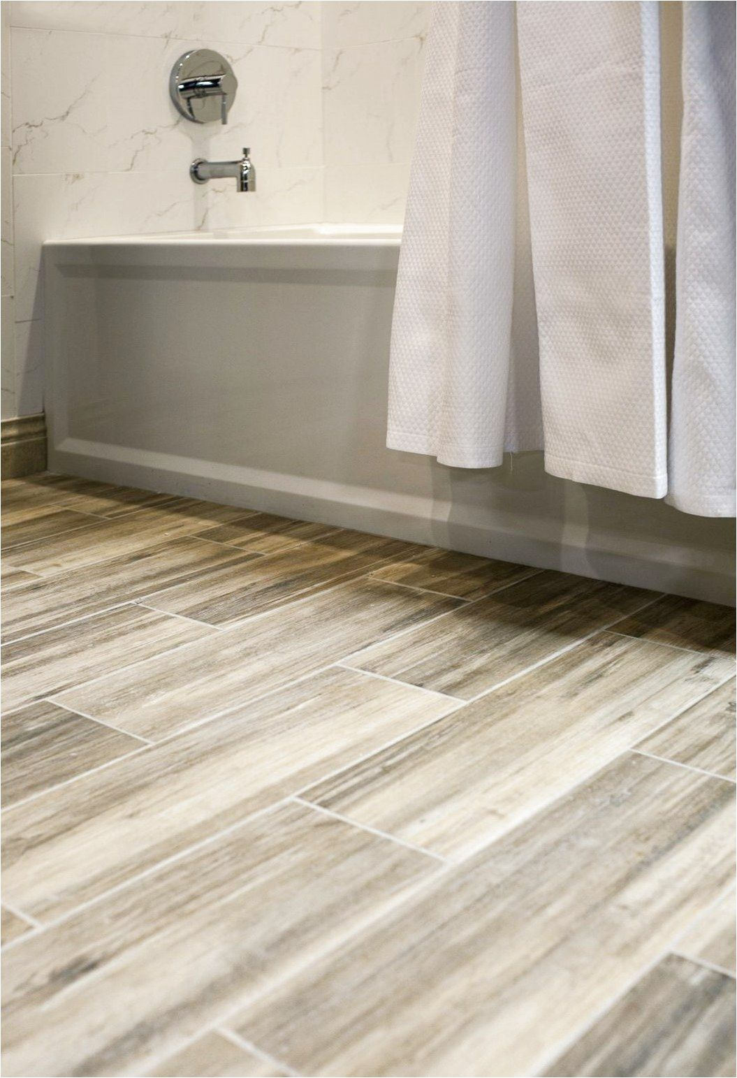 Faux Wood Ceramic Tile In The Bathroom Easy To Clean And Still Gets