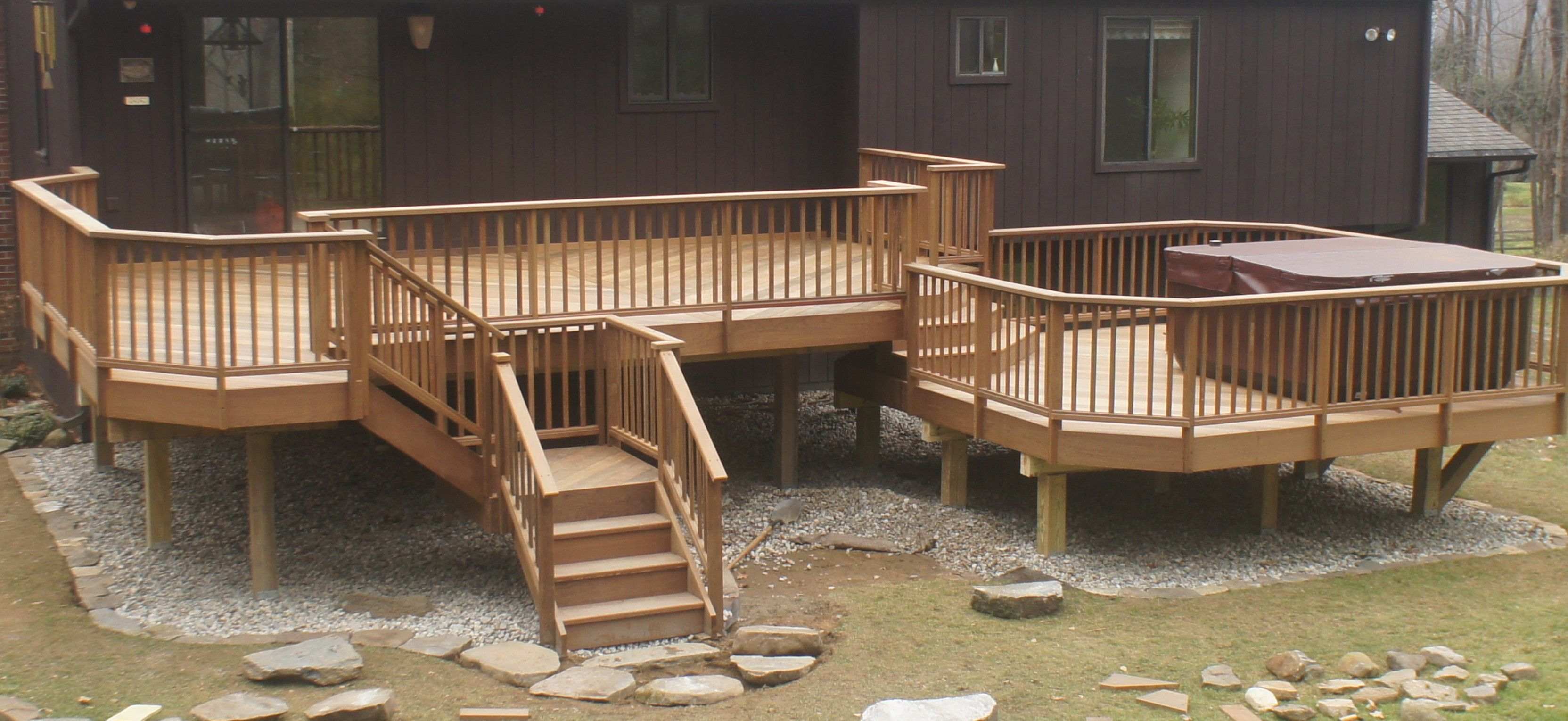The Complete Guide About Multi Level Decks With 27 Design Ideas Hot Tub Landscaping Multi Level Deck Hot Tub Deck