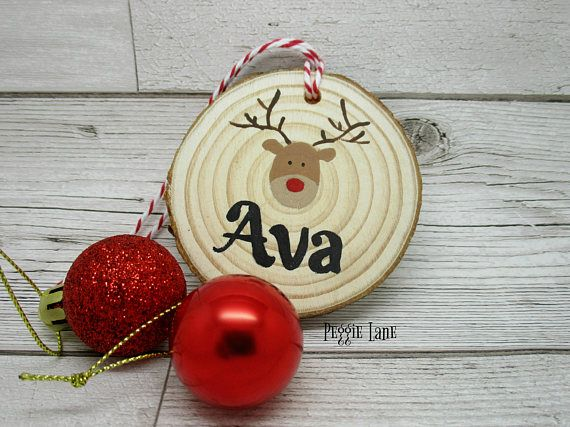 a personalised christmas tree decoration this reindeer log slice can be personalised with a name children love seeing their names on things