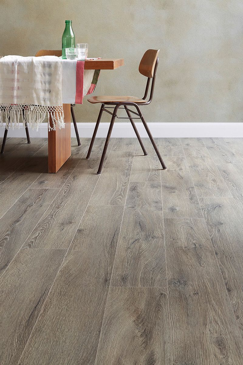 Series Woods Professional 12mm Laminate Flooring Campania Oak Is A Great Value Contemporary Grey Wood Look Fl Flooring Laminate Flooring Wood Laminate Flooring