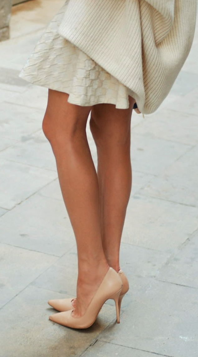 Slouchy sweater with a cream skirt