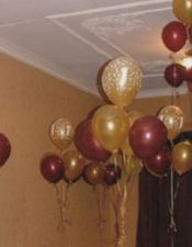 Baby Pink Burgundy And Rose Gold Balloons With Floral Arrangement