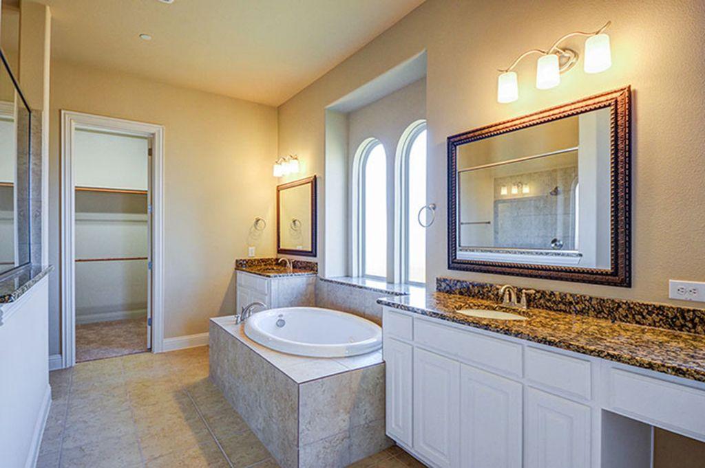 Gehan Homes Master Bathroom - Arched windows, granite countertops, white wood cabinets, tan tile, remodel, spa drop in tub. Dallas, Texas   Lakes of La Cima - Partridge #Gehanhomes