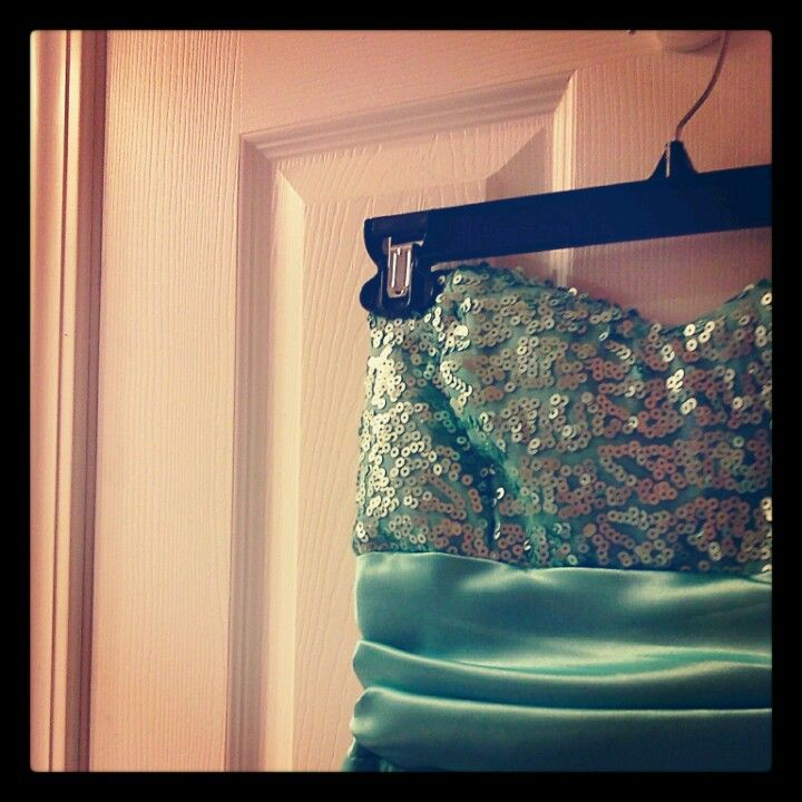 Here's a quick, inexpensive solution to getting wrinkles out of dresses that can't be washed or dry-cleaned. Simply hang the dress on the back of your bathroom door while taking a shower. The steam will release the wrinkles from your dress in no time, and it's way cheaper than having it professionally cleaned!