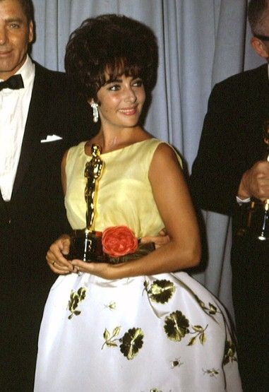 Elizabeth Taylor in Christian Dior, 1960 Elizabeth Taylor won her first of two Oscars in 1960 for her part in 'Butterfield 8'. She wore an embroidered Christian Dior gown and sported a tracheotomy scar having suffered from a bout of near-fatal pneumonia a few weeks before whilst filming 'Cleopatra'.