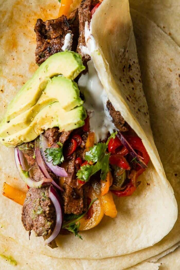 The secret to the best steak fajitas recipe is all about the marinade. You'll need three different citrus juices... ohsweetbasil.com #steakfajitarecipe
