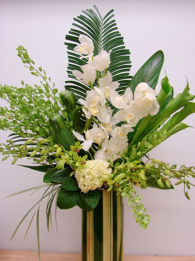 A Large Floral Display Of White Cymbidium Orchids Green Dendrobium Orchids A Large Flower Arrangements Tropical Flower Arrangements Orchid Flower Arrangements