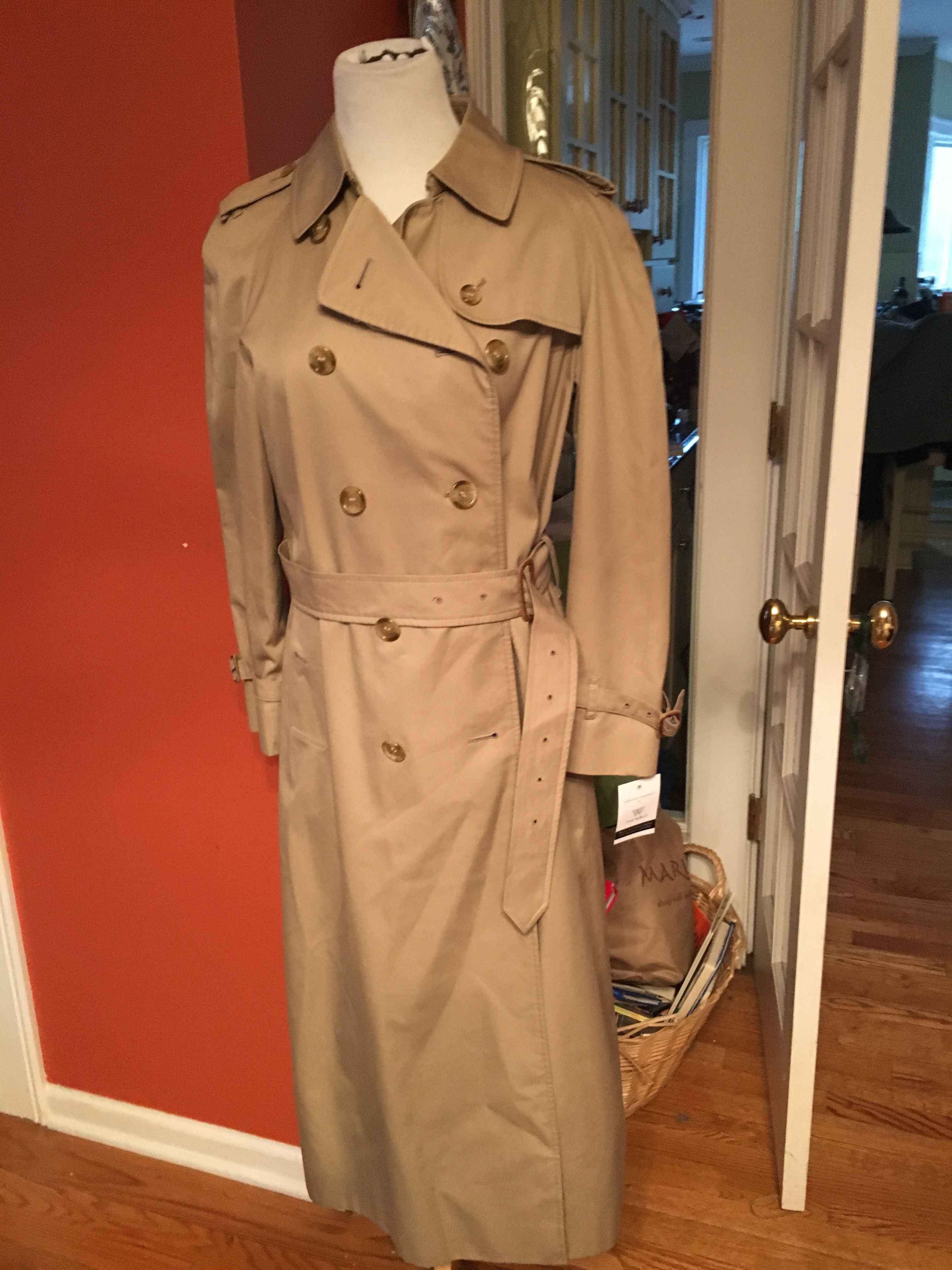 NWT Classic Burberry Tan and Novacheck Belted Trench Coat. Buttons in front and belt is adjustable. Size Medium, also fits a small and it is as classy as it is classic. Retails for $1850!