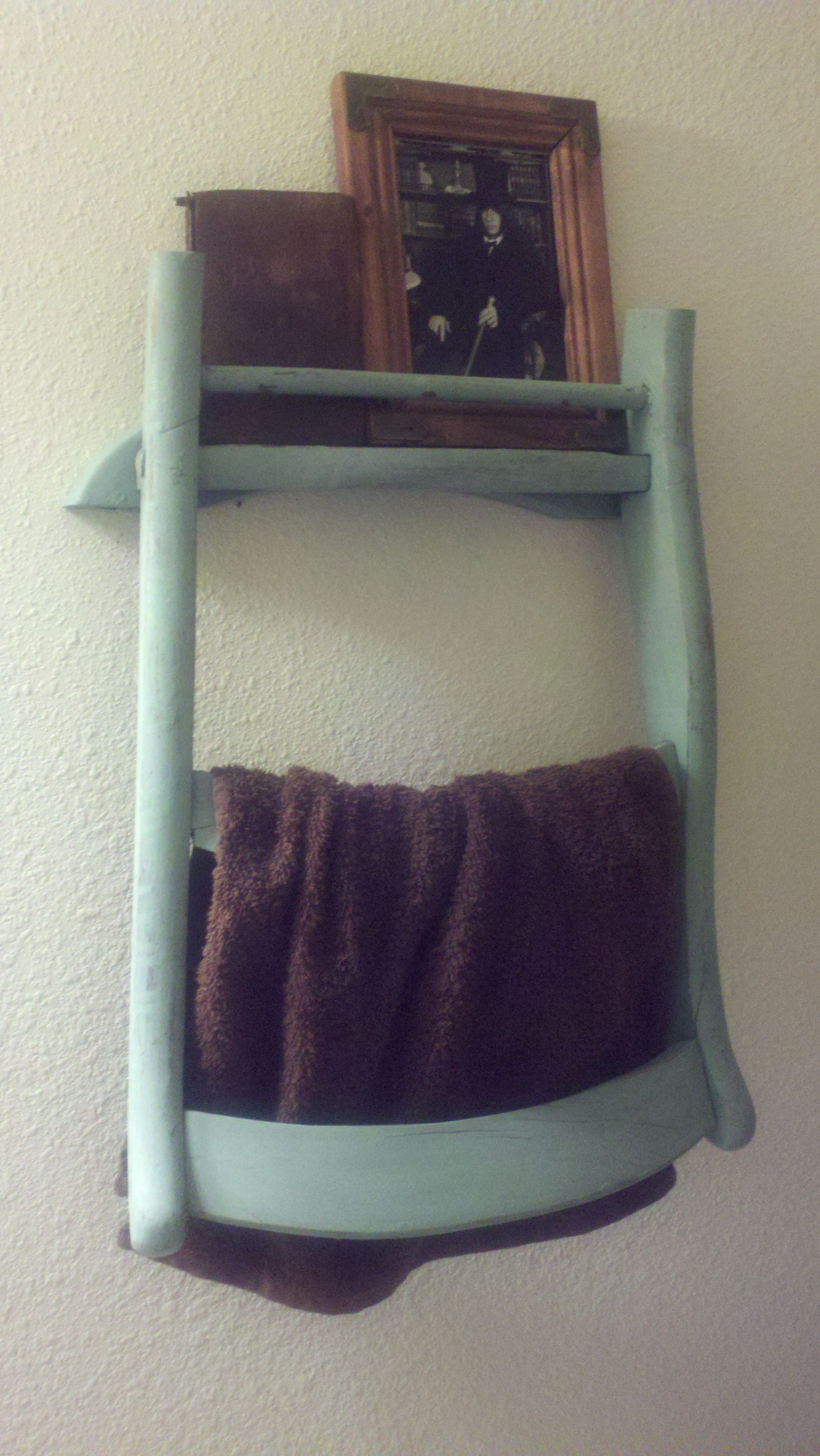 My old straight-backed wooden chair turned bathroom decor/hand towel rack! =)