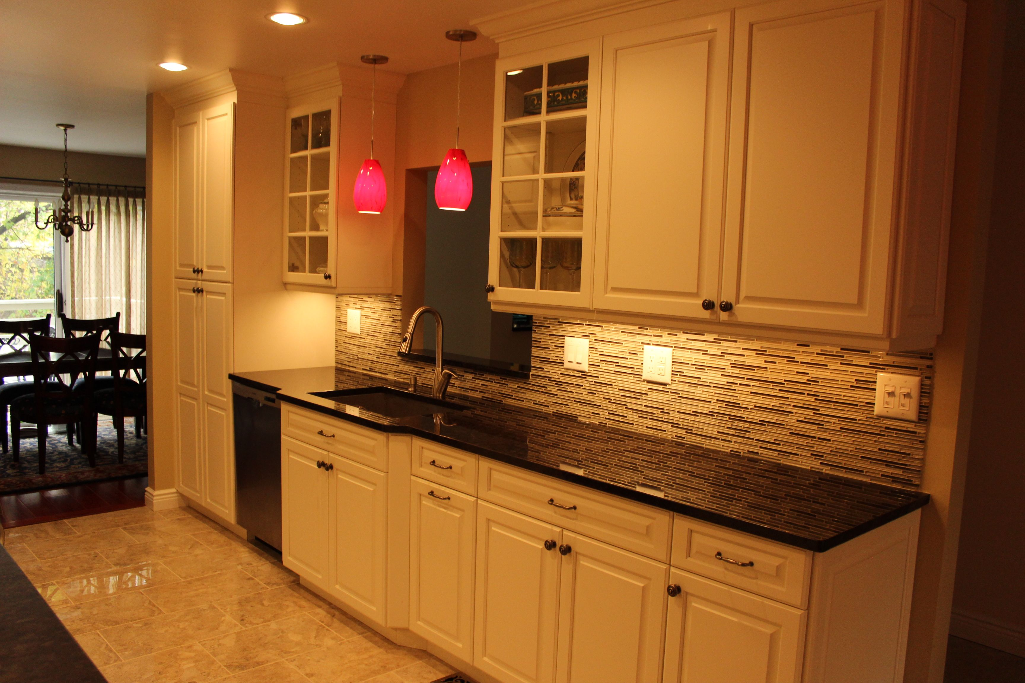 Designer Jodi Duerr Plain & Fancy Vintage Maple Cabinetry in dove low sheen paint Countertop Marron Cohiba Granite Backsplash Tile ADKO Heavy