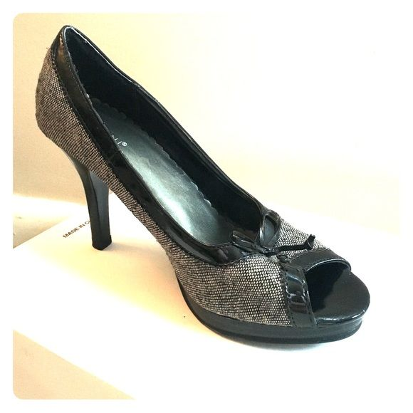 Fioni peep toe heels Leather and tweed peep toe heels. Tweed is a black a cream color. Each shoe has a leather tied bow by the toes. FIONI Clothing Shoes Heels