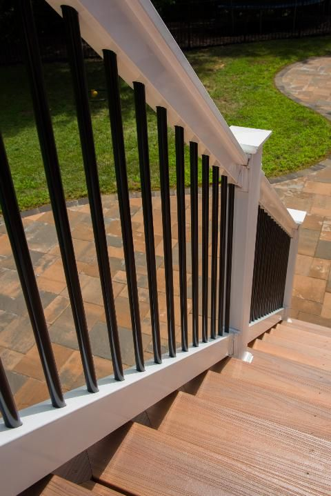 The New Deck Was Constructed Using Fiberon Horizon Series Composite Decking With An Ipe Inlay And Steps Tudor Brown Deck Railings Diy Deck Deck Railing Design