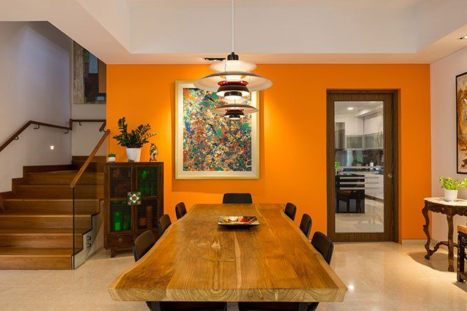 Thevivid yellow wall is a welcome addition to the predominantly white space. The bold hue instantly brightens up the area and adds to the tropical feel of the house.