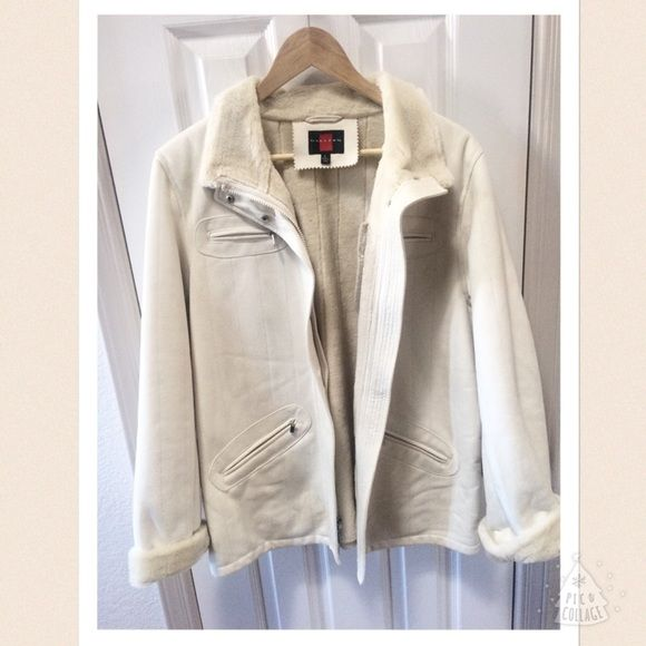 Cream/White leather jacket Great for winter! Has soft fury lining, freshly dry cleaned and extremely classic and chic. Very expensive piece..I am selling it for my mom and wish she wouldn't sell it but it's not her style. Hopefully it finds a good home! :) NO DEFECTS I've never sold such a high end item so price is negotiable but no low ball offers please! Comment for measurements if needed! Gallery Jackets & Coats