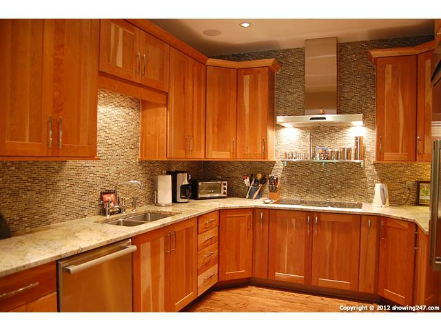 granite for natural cherry kitchen cabinets | ansley park