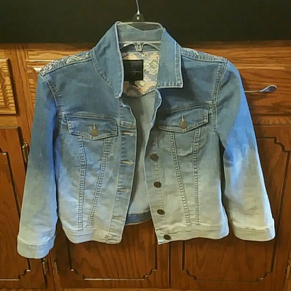 Jean jacket Adorable Jean jacket with tribal looking design on back, buttons up the front and has 2 pockets on each side of chest area. Excellent condition: worn maybe twice. No rips,  stains or snags. Jessica Simpson Jackets & Coats Jean Jackets