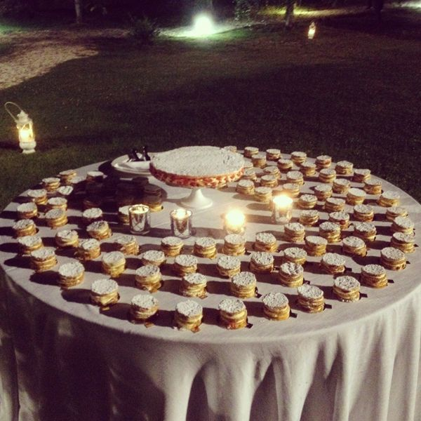Millefoglie traditional Italian Cake surrounded by lots of mini cakes