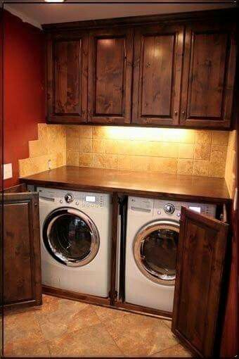 my dream laundry room itu0027s nice that laundry canu0027t fall behind machines and a folding table right on top i think iu0027d skip the doors in front of the