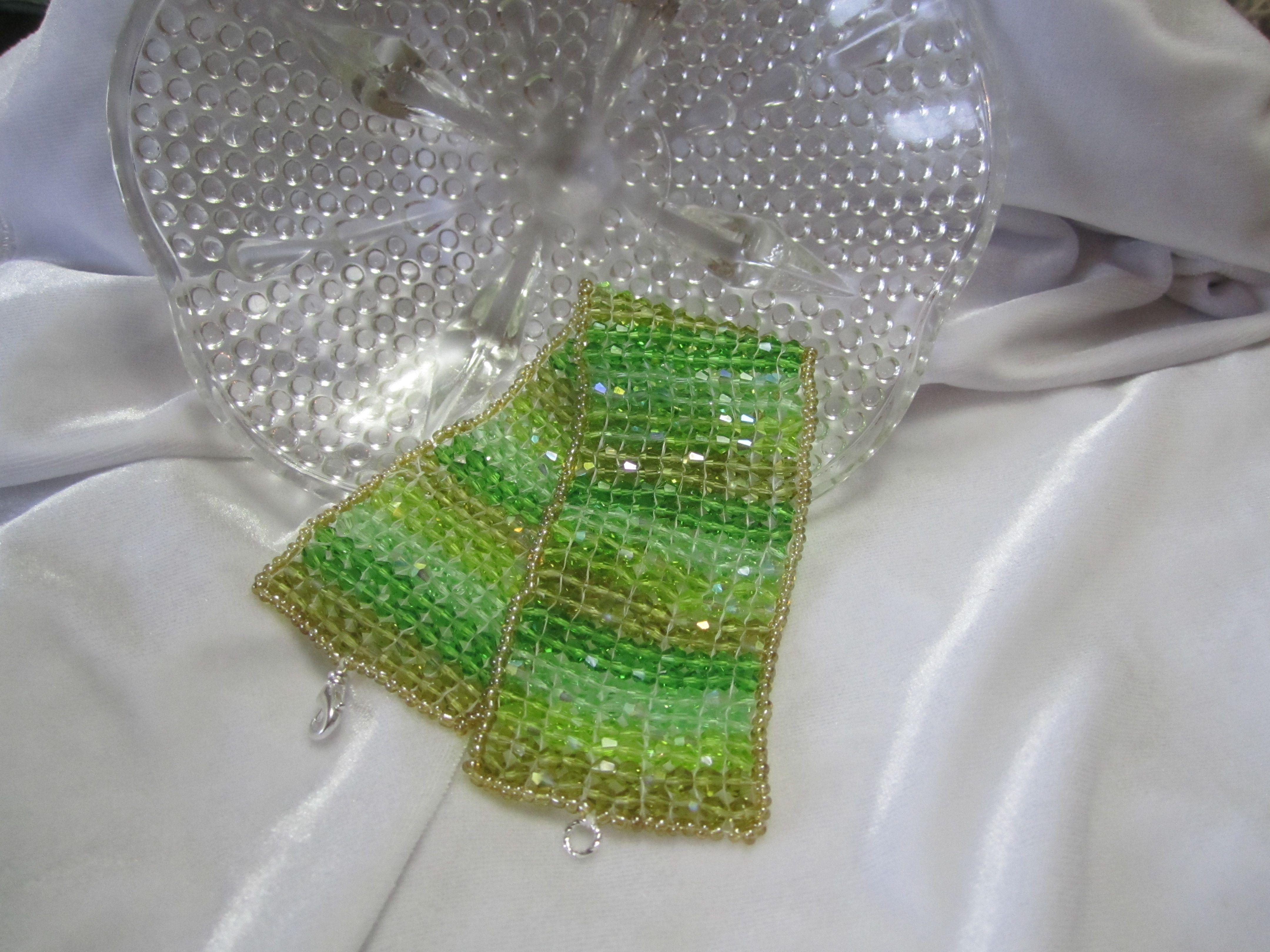 Swarovski AB2X Bicone Crystal Bracelet, shades of green, 1 1/2 inches wide, size 8.5.