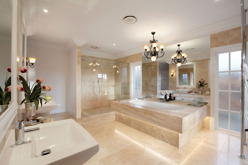A luxurious ensuite with double shower, island bath ...
