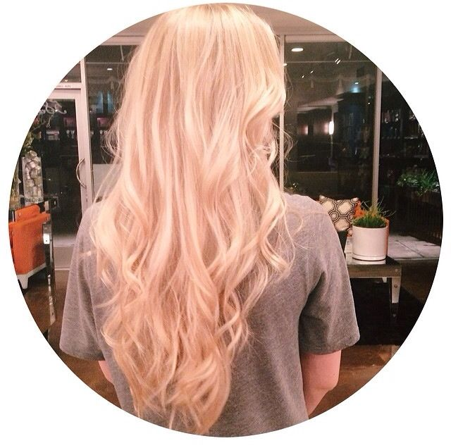 Platinum blonde long hair and waves. Hairstyle by Bella