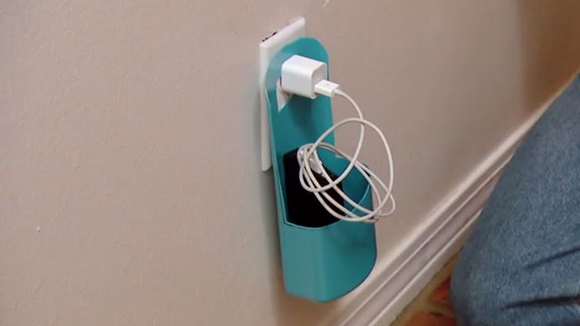 Make a cell phone charging station out of an empty plastic bottle!