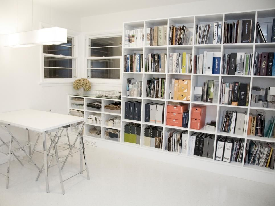 Books, binders and office supplies are all within site, but cube shelving prevents a cluttered look.