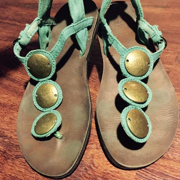 Aztec sandals Very comfy turquoise and brass sandals. The backstrap has stretch to it Shoes Sandals