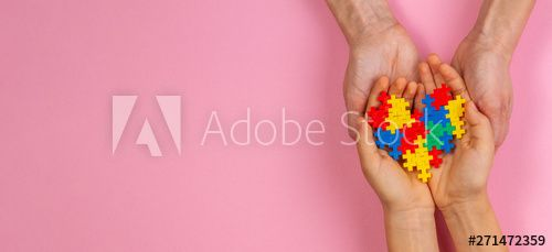 Adult and kid hands holding colorful heart on light pink background. World autism awareness day concept - Buy this stock photo and explore similar images at Adobe Stock