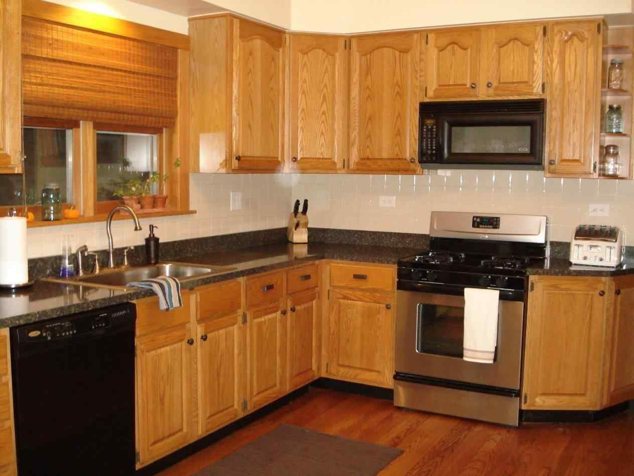 black stainless steel appliances with oak cabinets | Oak ...
