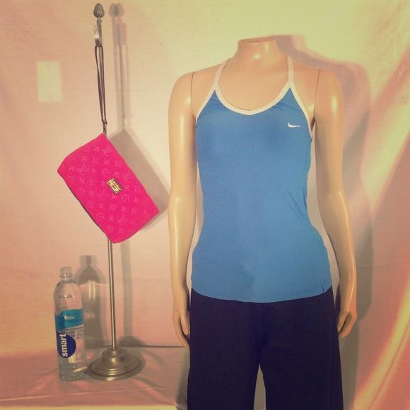 Nike blue white trim sport tank Nike blue white trim sport tank excellent condition no damage fabric polyester Nike Tops Tank Tops
