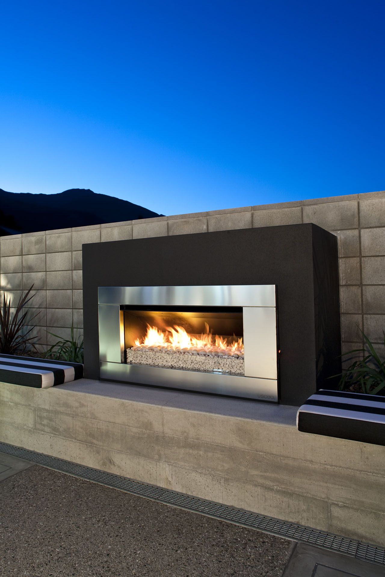 simple outdoor fireplace to compliment the industrial garden