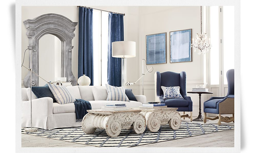 """I ADORE unifying """"classic"""" styles. Key: simply, simplify. TWO colors. Luckily, mine are blue & white. SHINING visual. Mod-industrial flr lamps, chandelier, wing-bk chrs, repurp-ed archtech/interest coff/table(blu books) abstract art, ornate-lite/cleanline hvy, paint/bleach flr counterprod-ing a darker flr anthrax-g entire room's feel-g of peace. Cheating encouraged upon completion. No premeditation. 1 bit o color @ a time. LET ART JUST HAPPEN. Thx..Restoration Hardware? Kidding! I kid! I do!"""