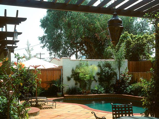 a new tile covered patio pool and spanish style pergola along with - Spanish Style Patio Ideas