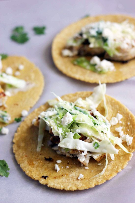 Fish Tacos with Cilantro Lime Slaw - make these healthy, restaurant-style tacos  at home!