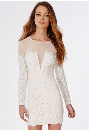 We are obsessing over this luscious lace mini dress. With nude underlay, this bardot illusion bodycon mini is covered in lavish white lace to the v neckline body contrasting with nude sheer mesh to the top and long sleeves. Team with dress ...